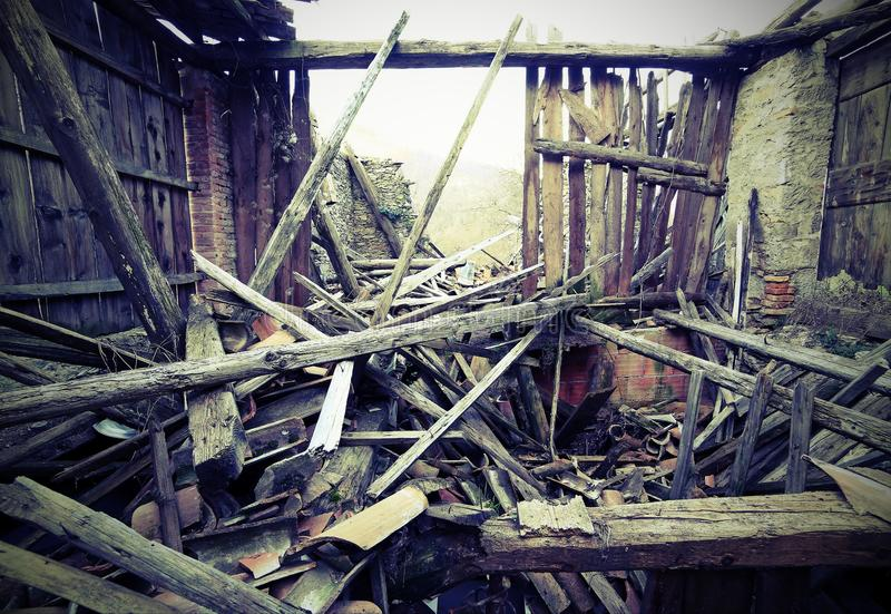 Rubble and the ruins of the house destroyed by earthquake with stock image