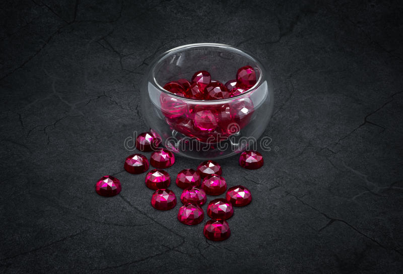 Rubies. Natural rubies on the cracked dark gray background stock photography