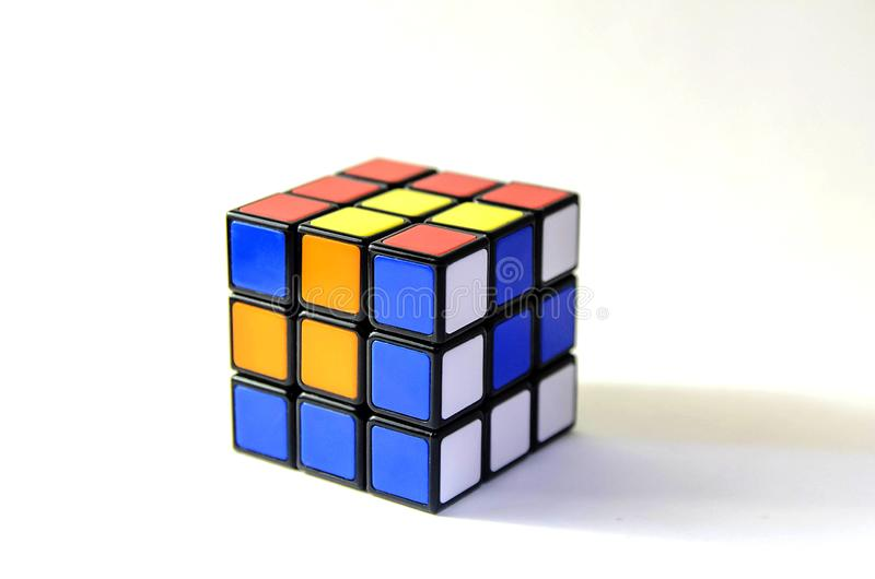 Rubik cube pattern. Blue, yellow, red, wight. In a classic Rubik`s Cube, each of the six faces is covered by 9 stickers, among six solid colours stock photo
