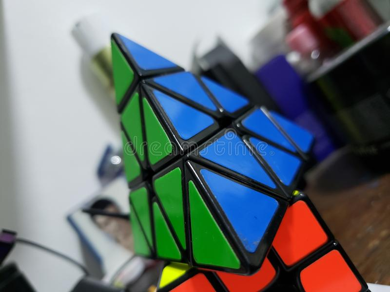 Rubik. Cube, triangle, , green, indoor royalty free stock photography