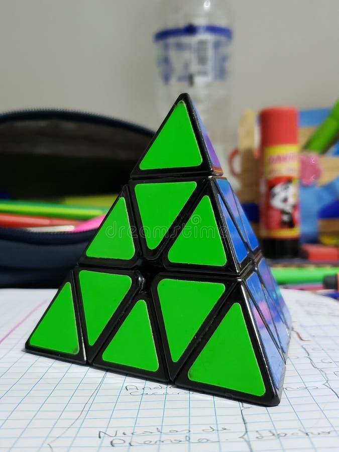 Rubik. Cube, triangle, , green, indoor, blue royalty free stock photos