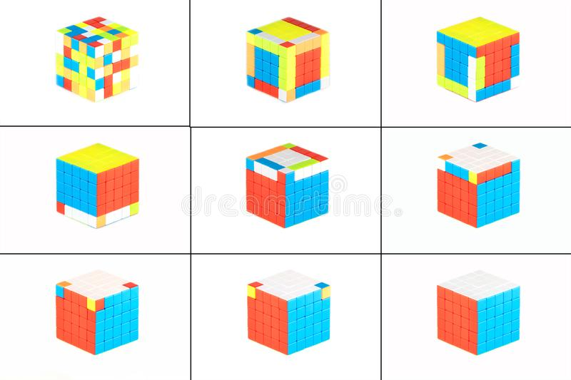 The Rubik`s cube five on five on the white background. The way of solution. The objects are isolated on white and a clipping path is provided for easy extraction royalty free illustration