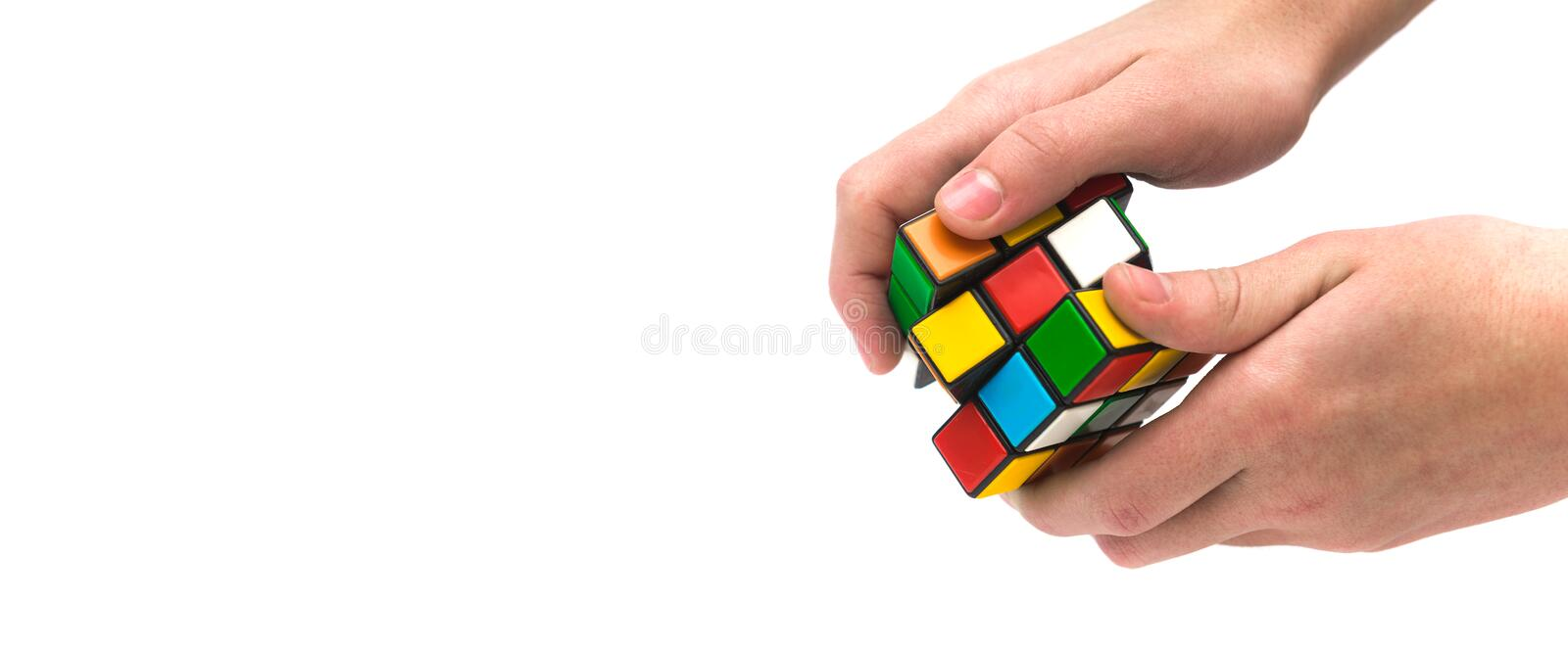 Rubik s cube in hand. Colorful and world famous Rubik`s cube in hand stock photography