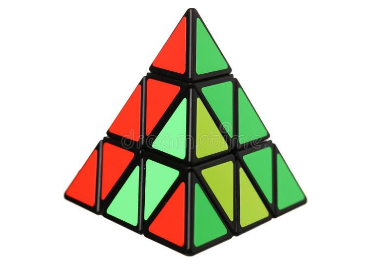 Rubiks kub i en form av en pyramid royaltyfri bild