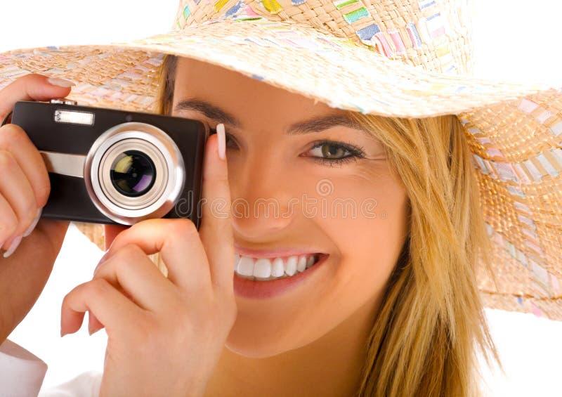 Rubio joven con la cámara imagen de archivo libre de regalías