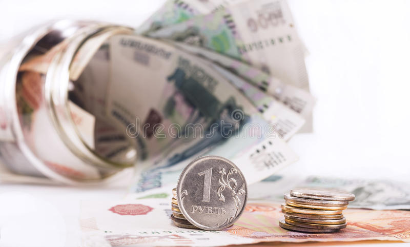 Ruble on the background of jar with money stock photography