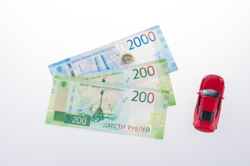Ruble banknotes and red toy car, Russian currency on a white background. concept of shopping or sales royalty free stock photography