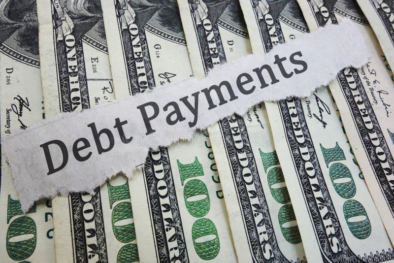 Rubrik för skuldbetalningnyheterna royaltyfria bilder