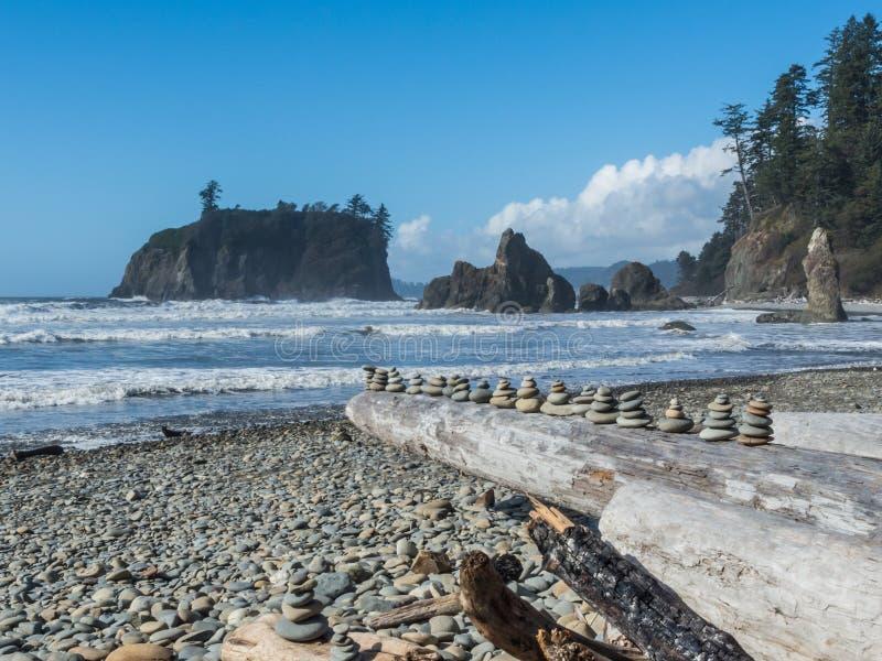 Ruby Beach in Olympic National Park. Rocks piled on logs at Ruby Beach in Olympic National Park in Washington royalty free stock image