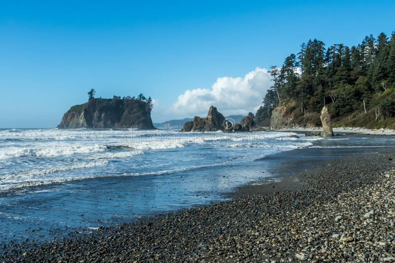 Ruby Beach in Olympic National Park. Waves roll onto Ruby Beach at Olympic National Park in Washington stock images