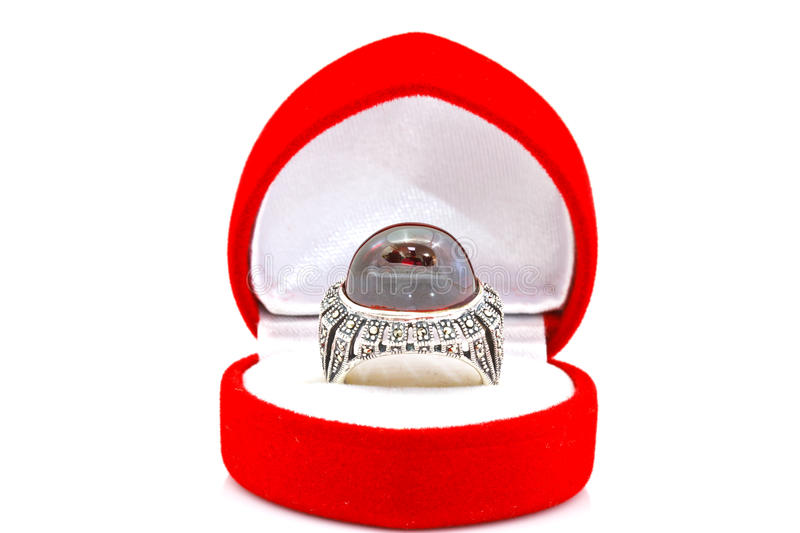 Ruby and diamond bezel style ring. On white royalty free stock image