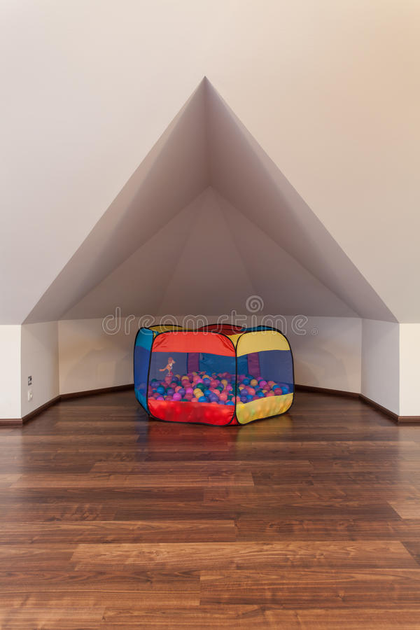 Ruby house - Nook for children. Ruby house - Cosy little nook for children in the attic stock photography