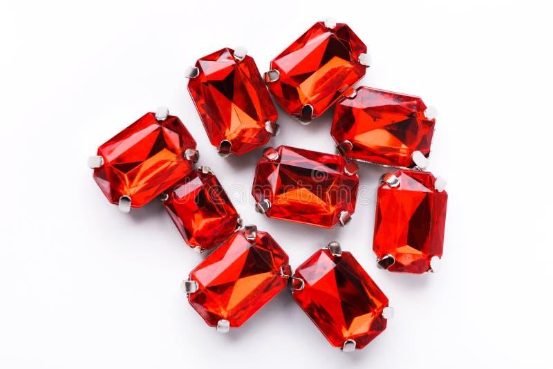Ruby loose gemstones pile on white background royalty free stock photo
