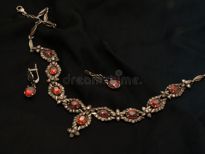 Ruby necklace and ear-rings royalty free stock photos