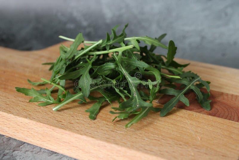 Ruccola salad on desk stock photos