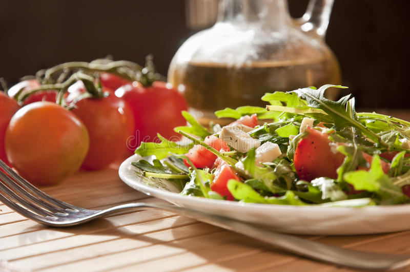 Ruccola salad with goat cheese royalty free stock photo