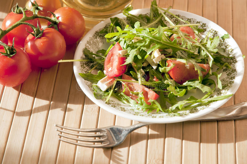 Ruccola salad with goat cheese and cherry royalty free stock photos
