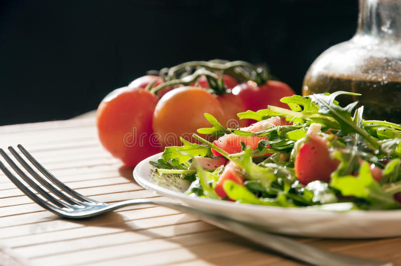 Ruccola salad with goat cheese and cherry stock images