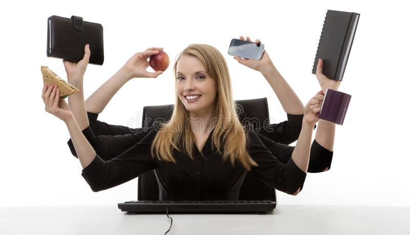 Ruchliwie kobieta przy jej biurkiem fotografia royalty free