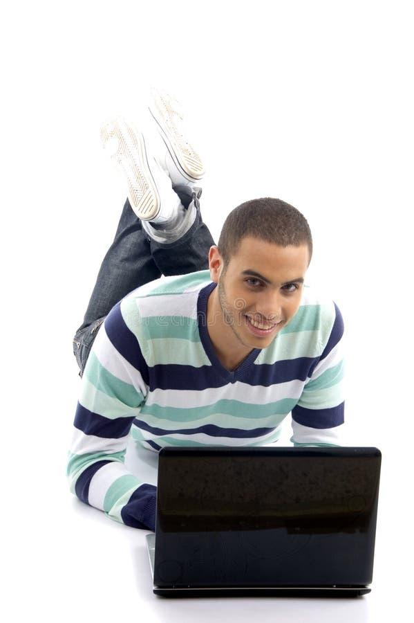 ruchliwie podłogowego laptopu łgarscy męscy potomstwa obraz royalty free