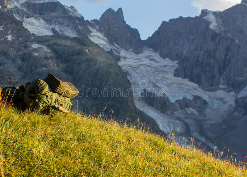Rucksack on a slope stock photos