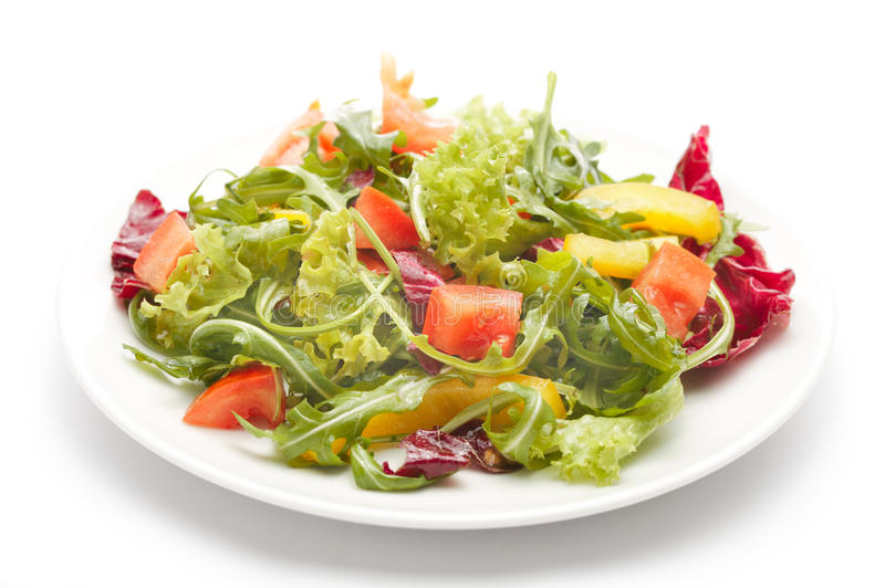Rucola salad. On a white plate stock image