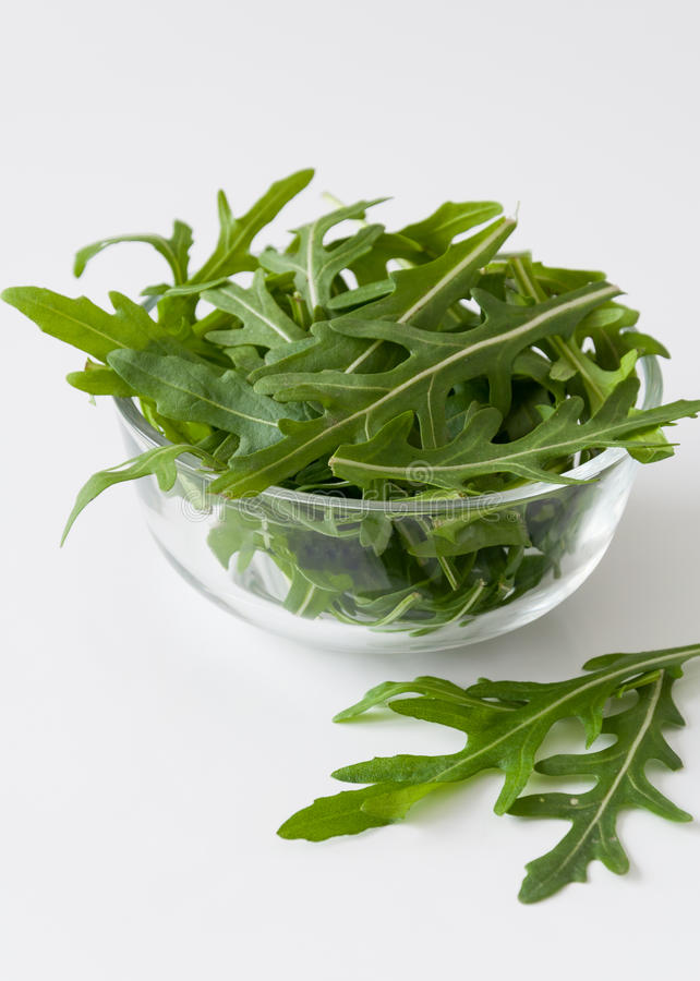 Rucola salad. In a glass bowl stock images
