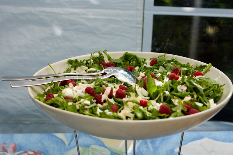 Rucola salad. With fresh raspberries and fetta royalty free stock photography