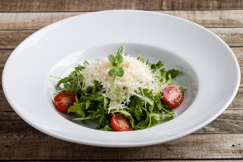 Rucola salad. Fresh tasty healthy rucola salad in white plate royalty free stock photography