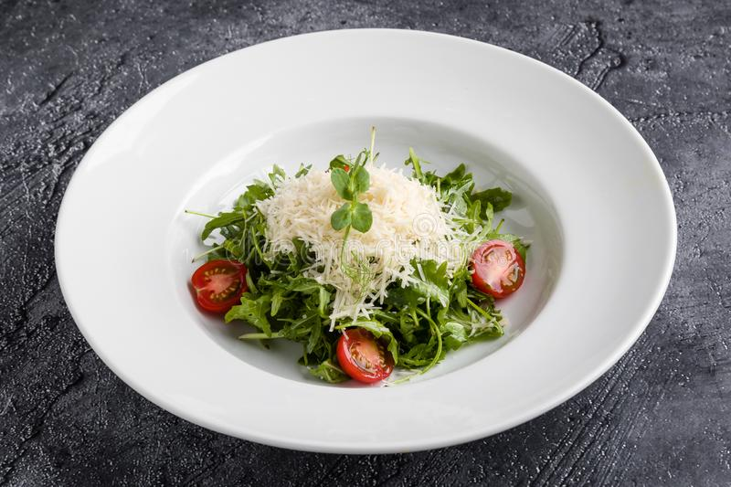 Rucola salad. Fresh tasty healthy rucola salad in white plate stock photos
