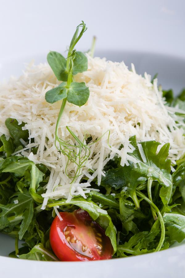Rucola salad. Fresh tasty healthy rucola salad in white plate stock image