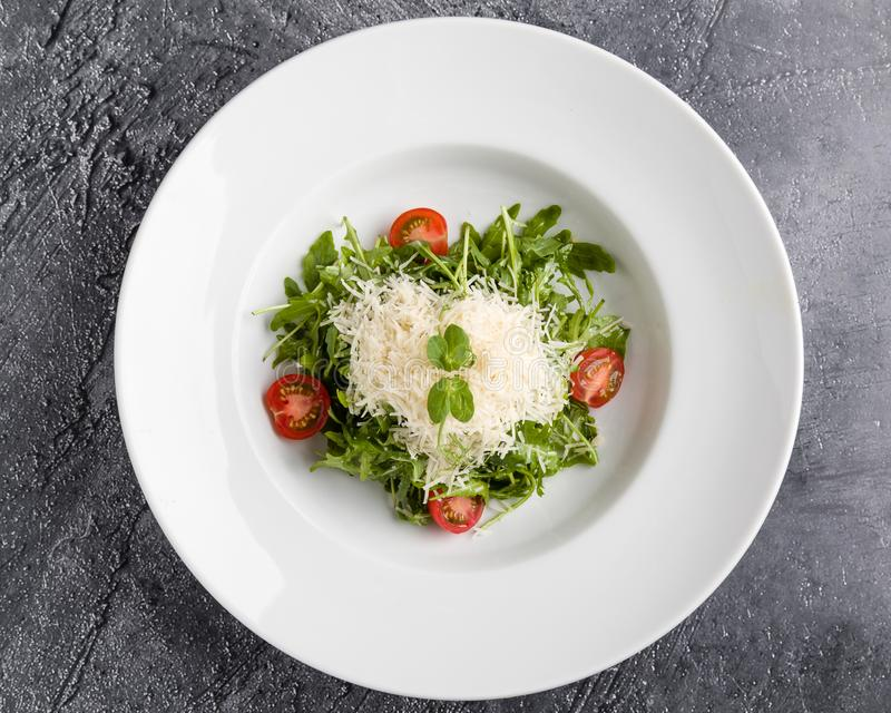 Rucola salad. Fresh tasty healthy rucola salad in white plate royalty free stock photos