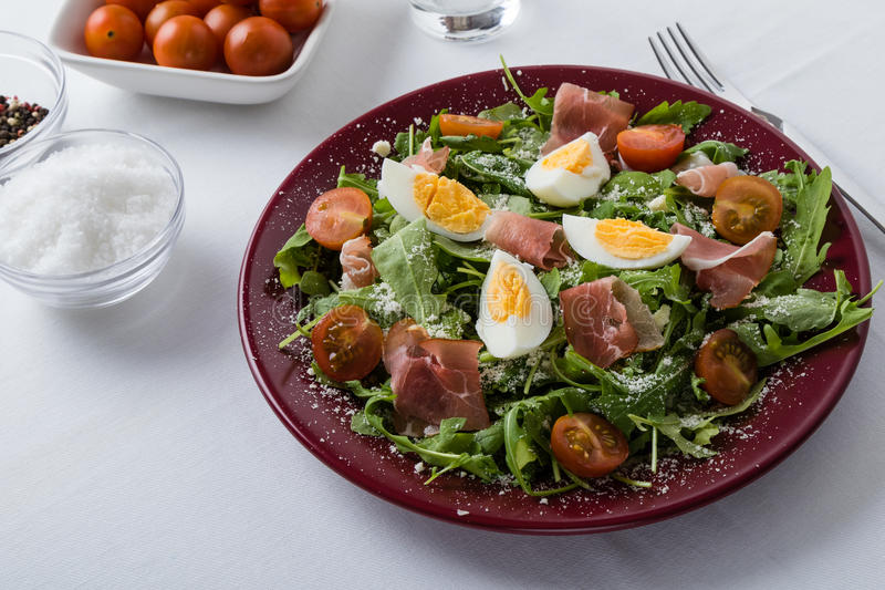 Rucola salad. With ham, cheese and tomatoes stock images