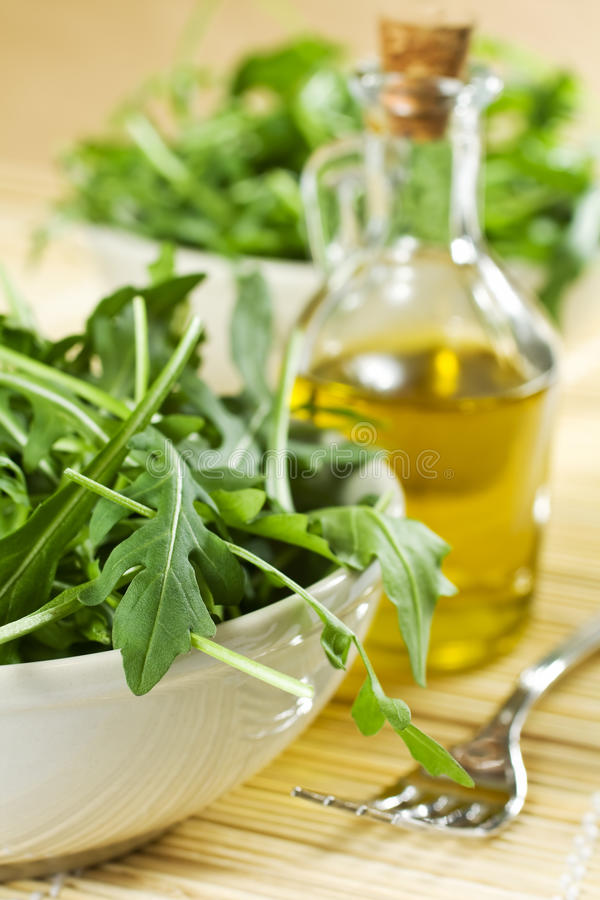 Rucola Salad And Oil. Closeup Of Fresh Rucola Salad And Oil royalty free stock photography