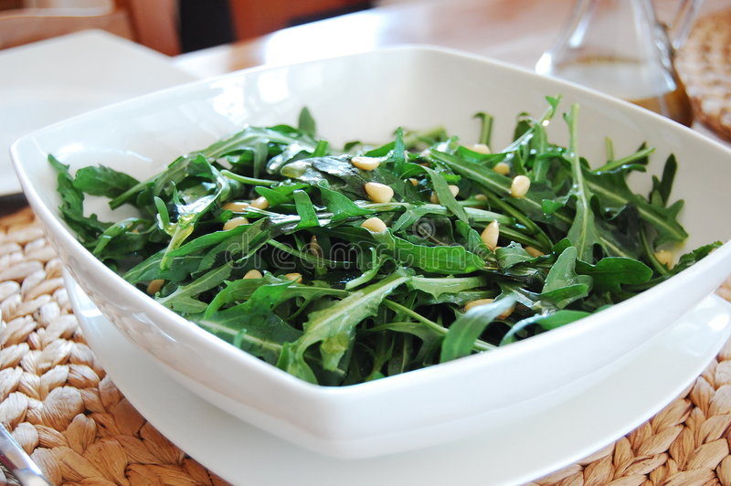 Rucola salad and olive oil royalty free stock photography