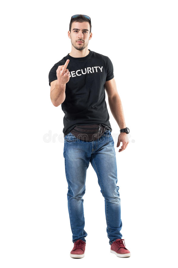Rude police officer in civilian plain clothes showing middle finger gesture at camera. Full body length portrait isolated on white studio background stock images