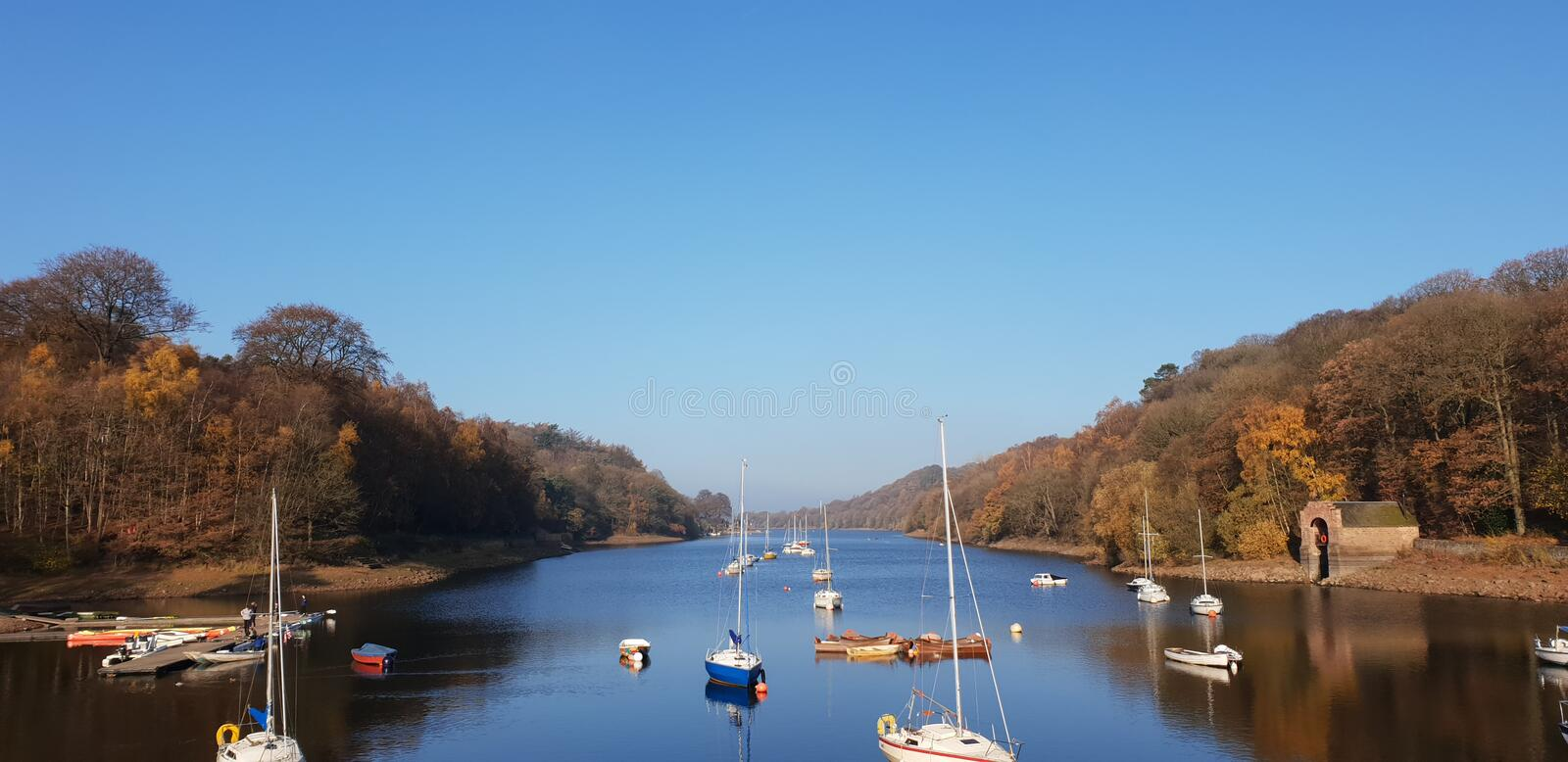 Boats and lake. Rudyard lake Autumnal picture, Lake, Boats, Beach.rnMirror Lake. Peace. Chill royalty free stock images
