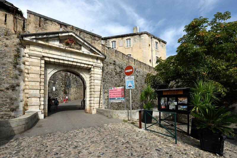 Porte sur la Rue du Donjon, Corte, Corse, France. Historic ancient gate in the street `Rue du Donjon` in the center of Corte old town on Corsica island - France royalty free stock image