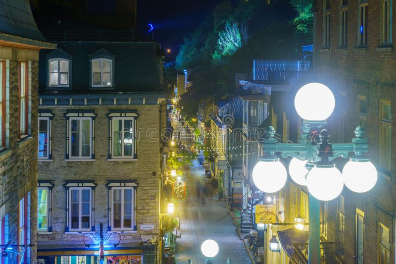 Rue du Petit Champlain street in Quebec City. Quebec City, Canada - September 26, 2018: Night view of the Rue du Petit Champlain street with locals and visitors stock images