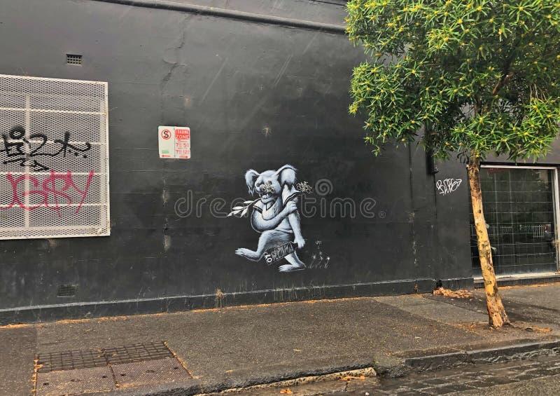 Rue iconique d'Australie de Melbourne de koala blanc grunge de graffiti photo libre de droits