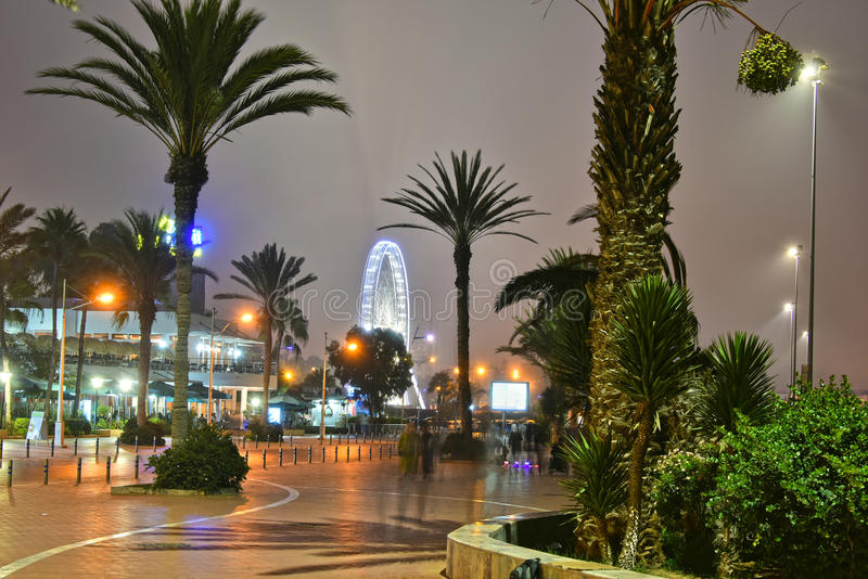 Rue La Plage by night in Agadir, Morocco. AGADIR, MOROCCO - SEPT 29, 2016: Rue La Plage by night. Agadir is one of the major urban centres of Morocco and famous stock photo