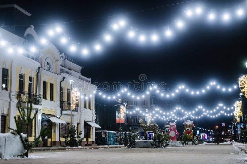 Rue nocturne de Christmass photos stock