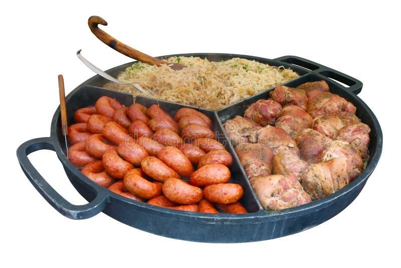 Rue-nourriture rapide - saucisses de proc fumées quartier de porc et cabba cuit photographie stock libre de droits