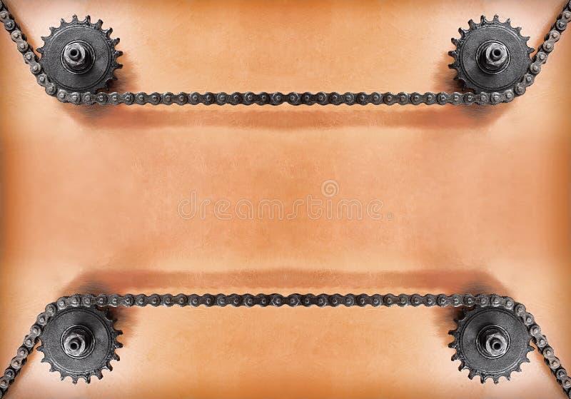 Ruedas dentadas y cadena doble en fondo del grunge con el espacio vacío foto de archivo libre de regalías