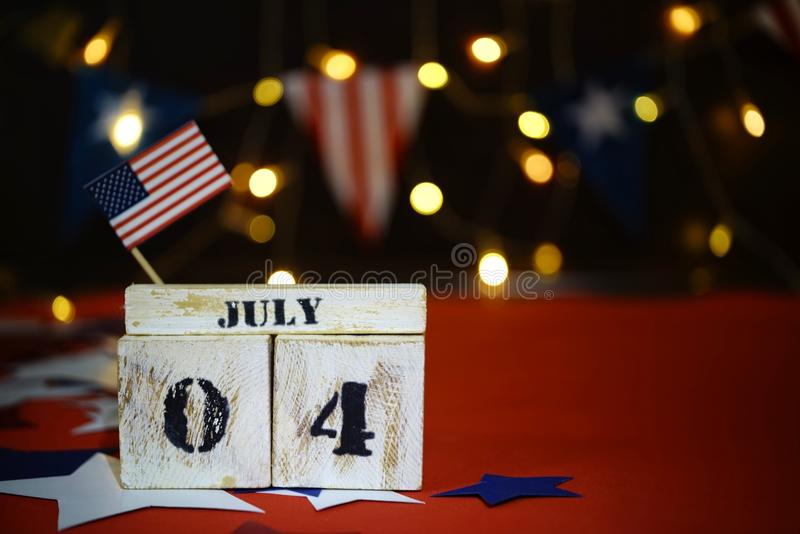 Ruffled American flag and wooden cube calendar with 4th of July, USA Independence Day date, copy space celebratory background. US. Patriotic festive composition stock photography