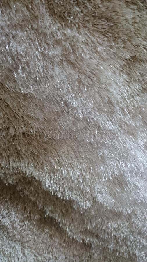 Rug texture. The rug resembles fur of a dog, perhaps stock photography