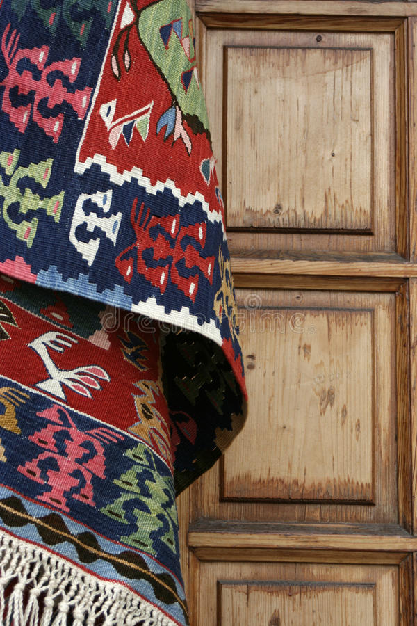 Rug And Wood Door royalty free stock image