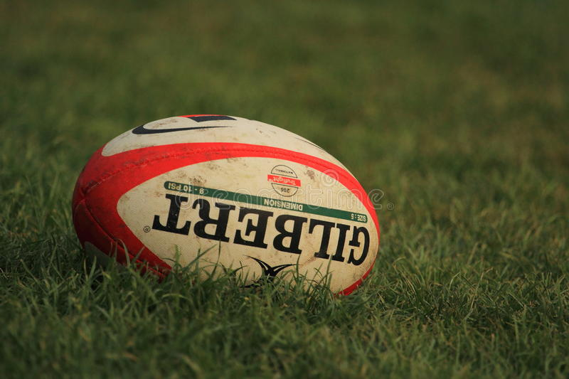 Rugby ball Gilbert. The rugby ball Gilbert lying in the grass stock photos