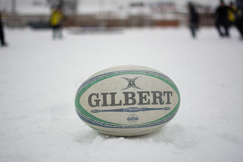 Rugby ball Gilbert. Yoshkar-Ola, Russia - January 21, 2018 The official ball of the European Rugby Championship Gilbert lies on the snow stock image