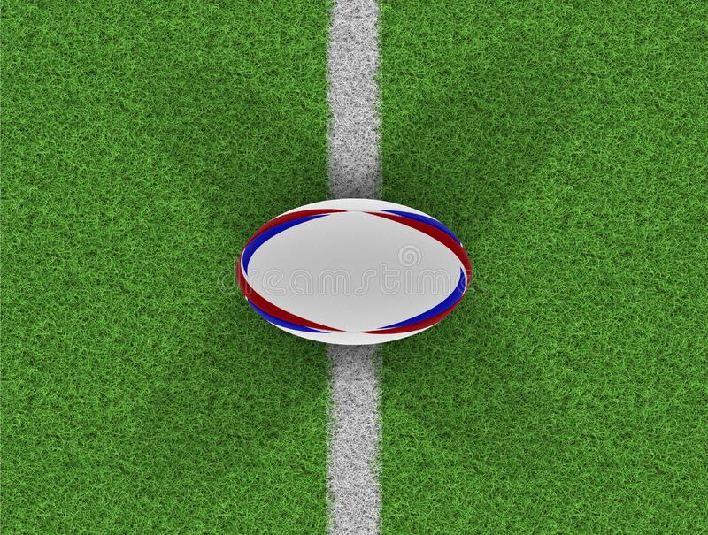 Rugby Ball On Grass Pitch royalty free stock photography